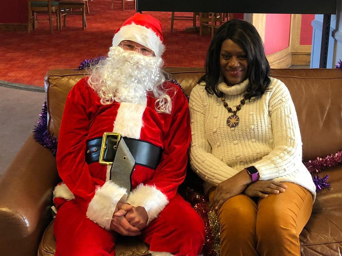 Parliamentary candidates Eleanor Smith, right, and Stuart Anderson, dressed as Father Christmas, left. Photo: Lesley Stamps