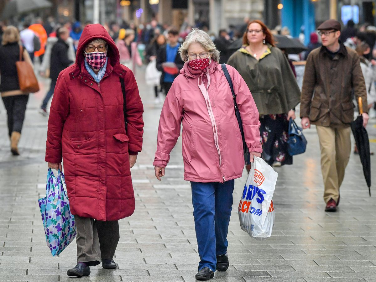Shoppers wear face coverings
