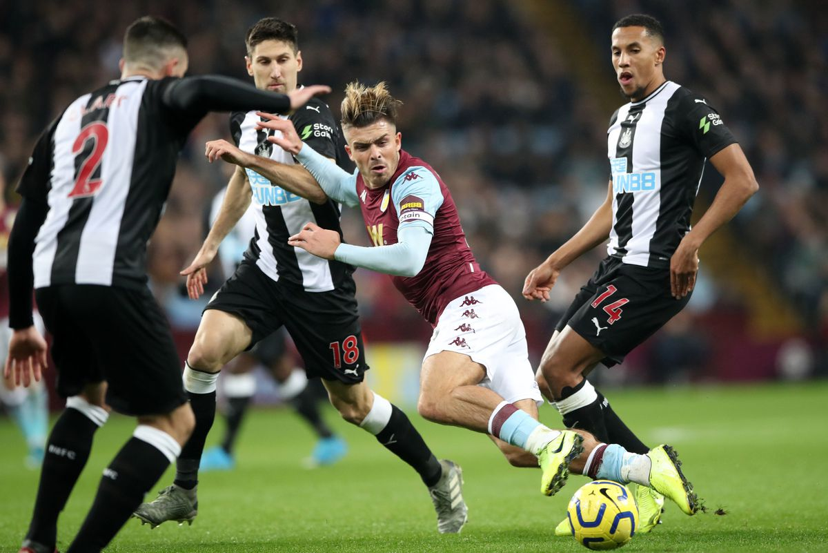 Aston Villa's Jack Grealish is tackled by Newcastle United's Federico Fernandez and Isaac Hayden (Nick Potts/PA Wire)