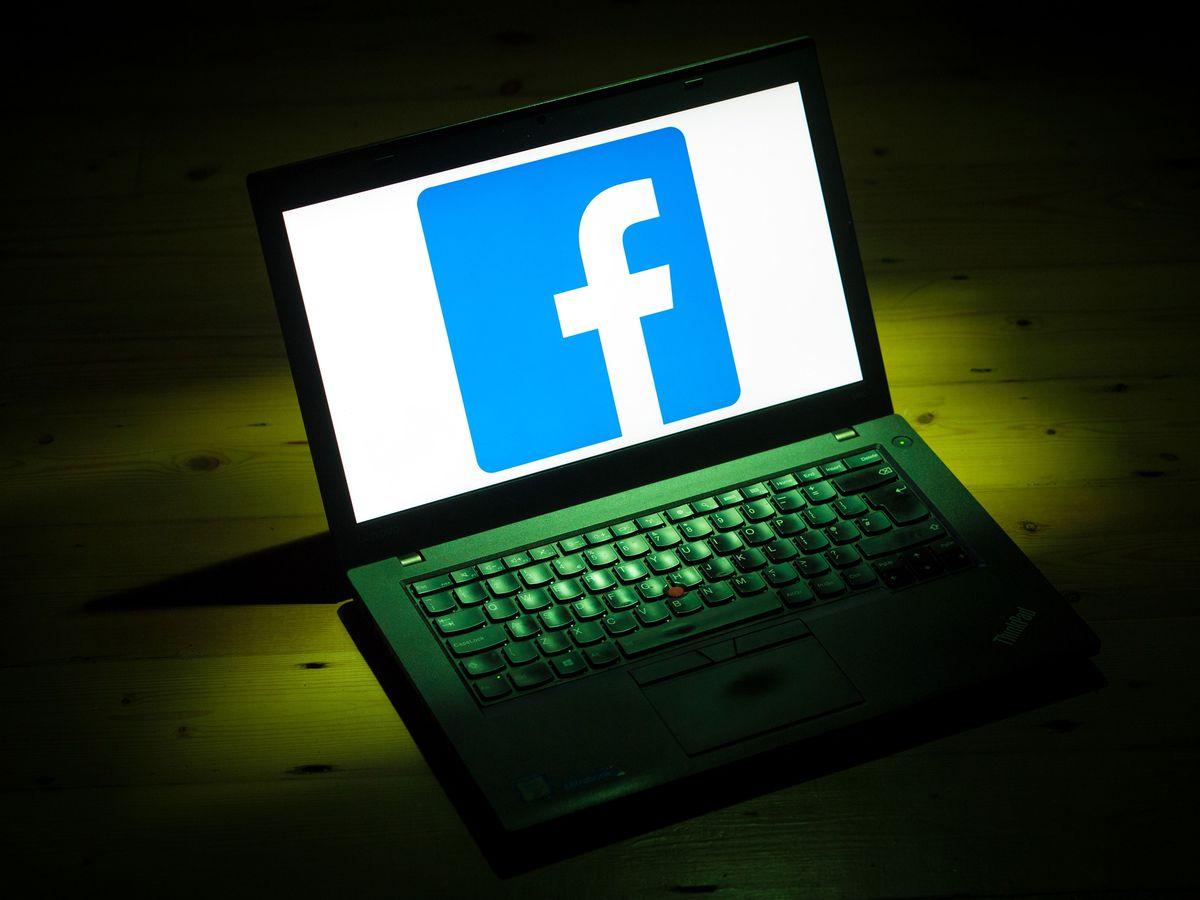 Facebook logo on laptop