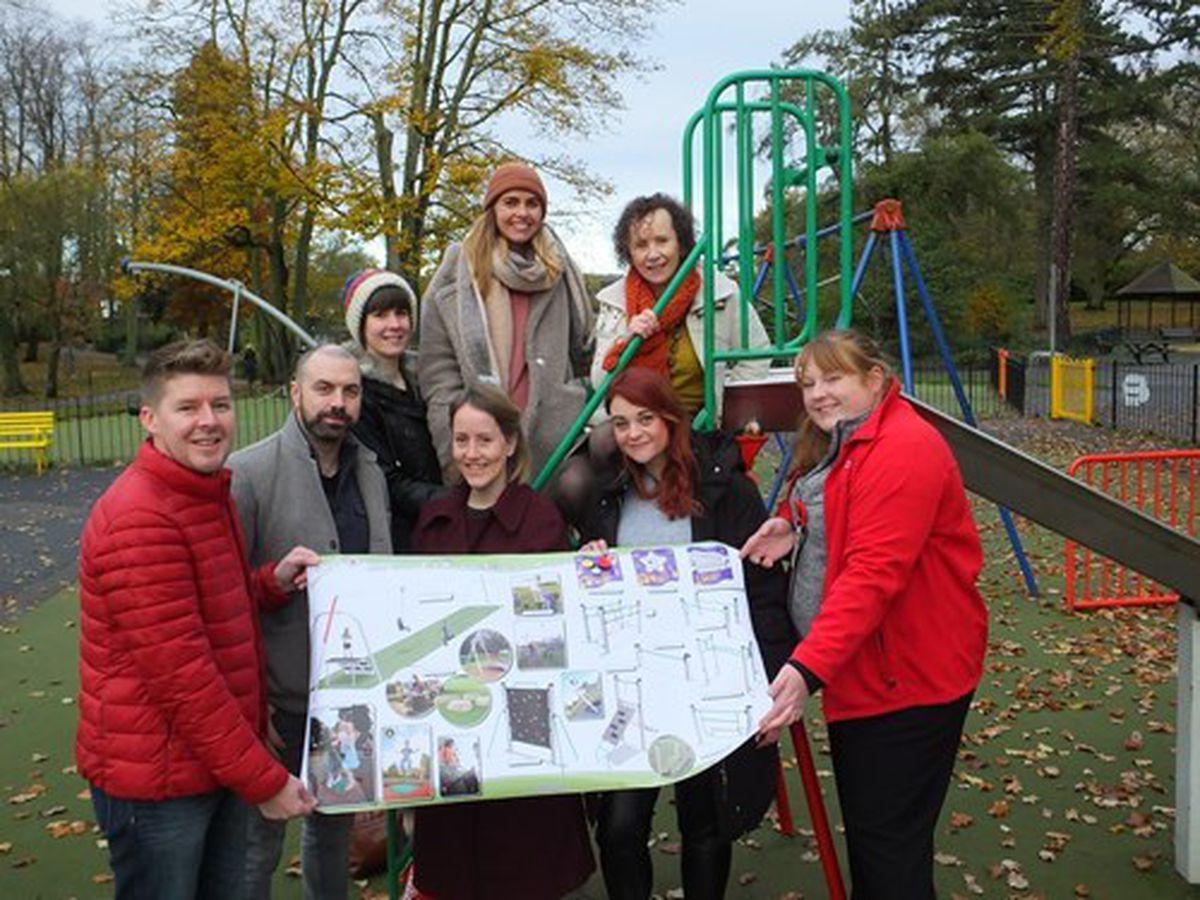 Friends of Mary Stevens Park members celebrate the park improvement news