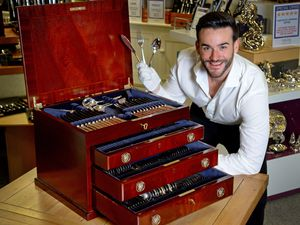 James Price with the cutlery canteen set being sold for £5,000 as part of a reopening sale
