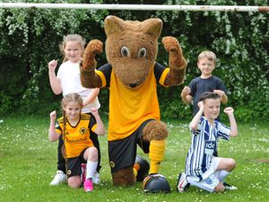Wolfie pays a visit to pupils at Bramford Primary School, in Coseley. (School won't give pupil's names)