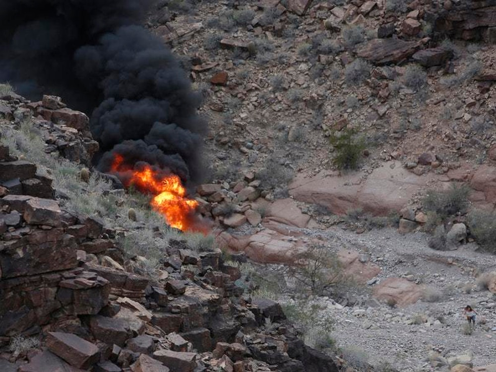 The scene of a helicopter crash which killed three Britons at the Grand Canyon