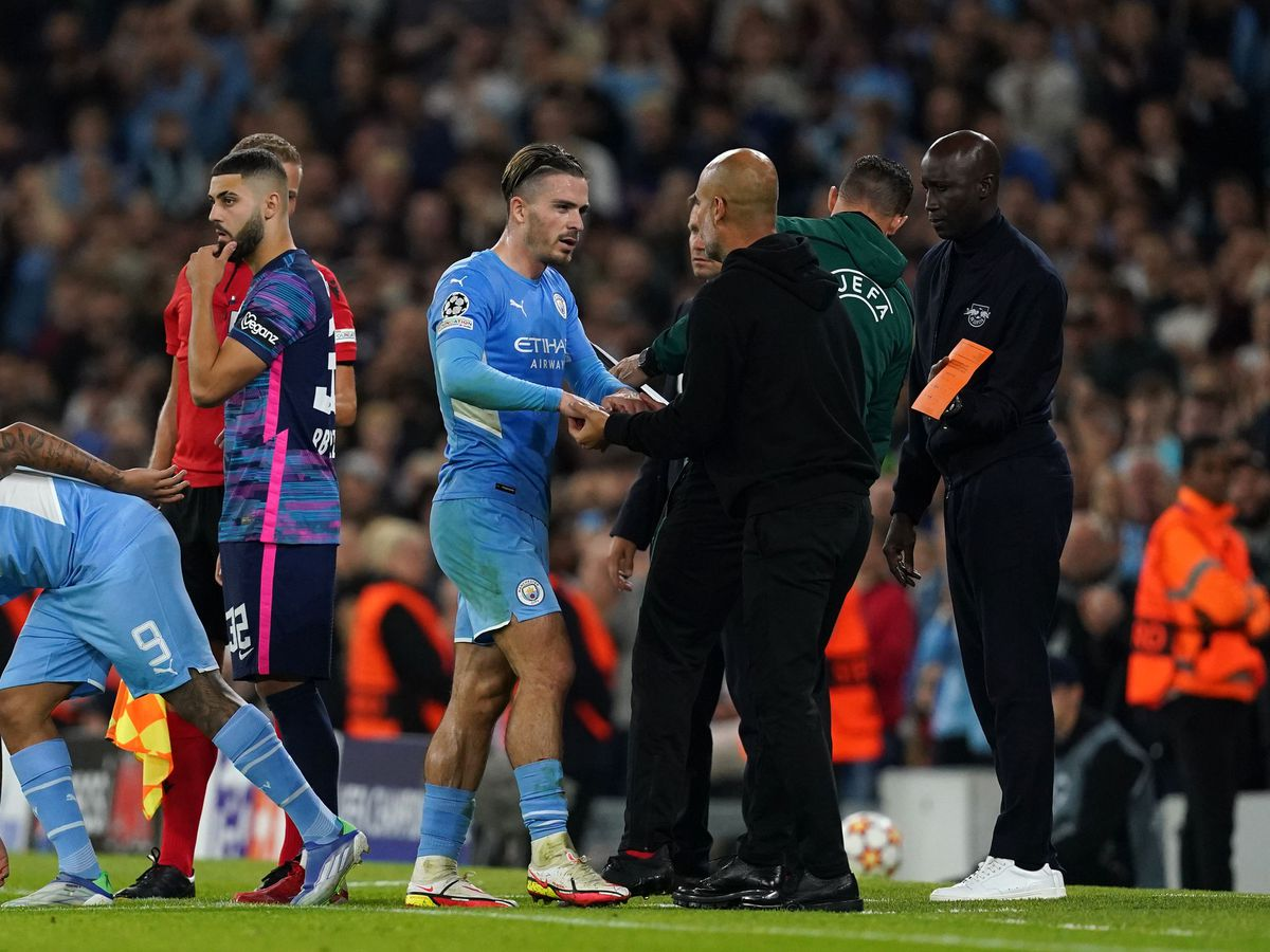 Jack Grealish (centre) shakes hands with manager Pep Guardiola