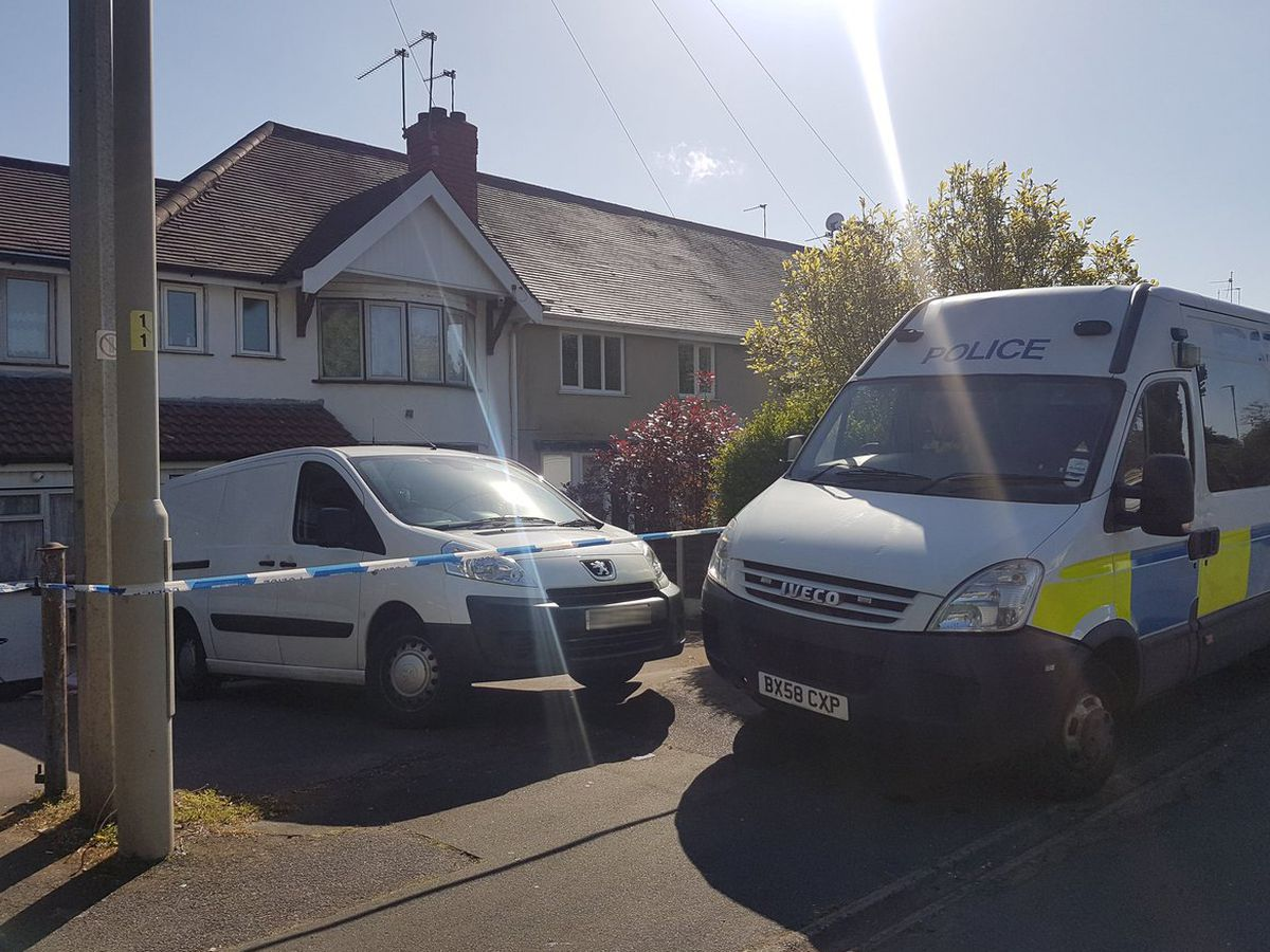 A police cordon is in place after the murder investigation is launched in Highgate Road, Holly Hall, near Brierley Hill