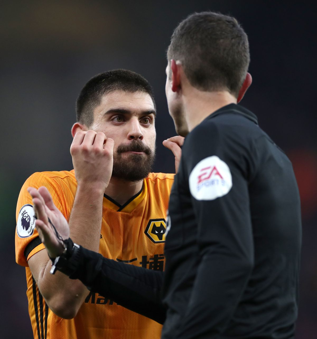 Wolverhampton Wanderers's Ruben Neves gestures to referee David Coote