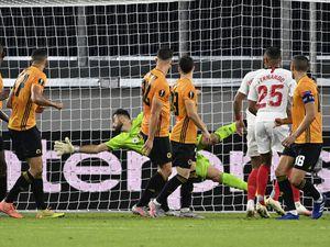 Wolverhampton Wanderers' goalkeeper Rui Patricio fails to stop a goal from Sevilla's Lucas Ocampos (PA)