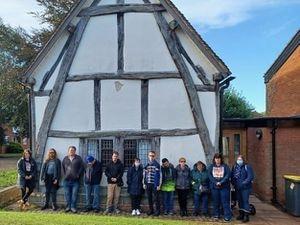 Members of Friends2Friends outside Cruck House in Lichfield.