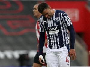 Hal Robson-Kanu of West Bromwich Albion reacts in pain after injuring his right arm. (AMA)