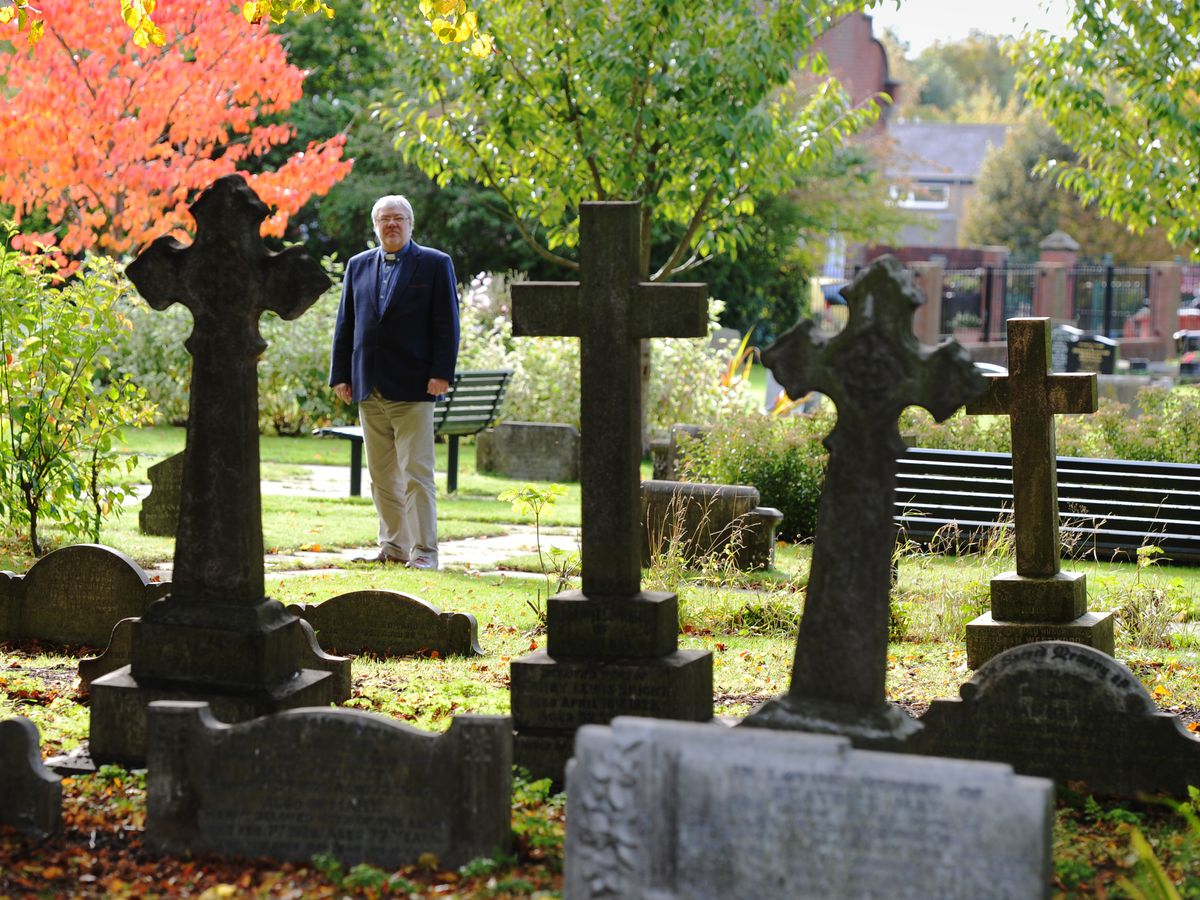 Rev Richard Merrick in the grounds at Holy Trinity Church which have been spruced up