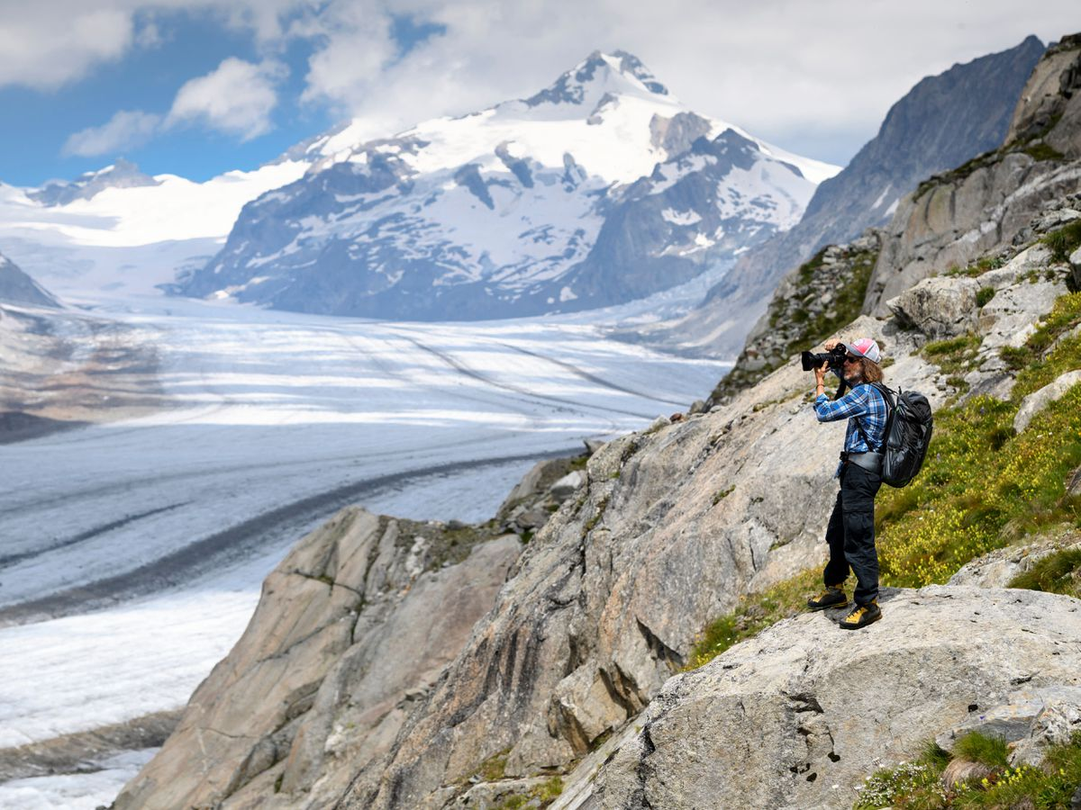 Photographer David Carlier takes pictures of the Swiss Aletsch glacier, the longest glacier in Europe, in Fieschertal