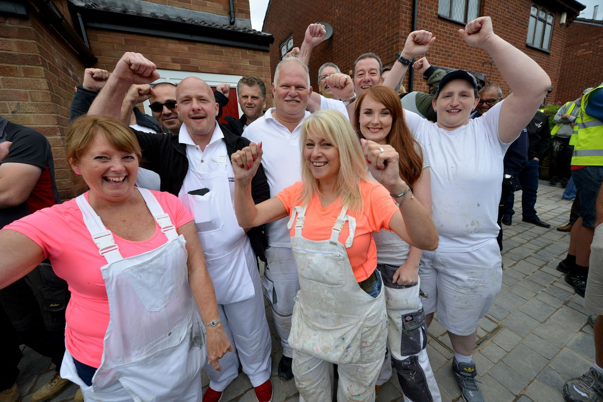 It's all smiles to mark the end of the DIY SOS project