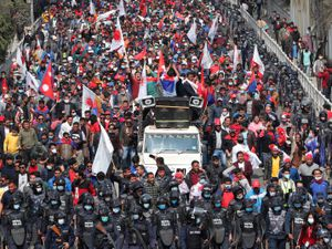People in Nepal celebrate a court order demanding the reinstatement of Nepal's parliament