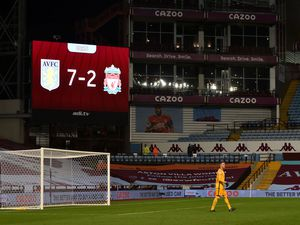 """Liverpool goalkeeper Adrian in front of the big screen displaying the 7-2 scoreline during the Premier League match at Villa Park, Birmingham. PA Photo. Picture date: Sunday October 4, 2020. See PA story SOCCER Villa. Photo credit should read: Peter Powell/NMC Pool/PA Wire. RESTRICTIONS: EDITORIAL USE ONLY No use with unauthorised audio, video, data, fixture lists, club/league logos or """"live"""" services. Online in-match use limited to 120 images, no video emulation. No use in betting, games or single club/league/player publications.."""