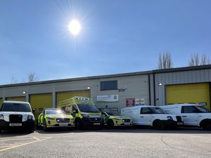 Three of the new vans either side of the trust's other electric vehicles. Photo: WMAS
