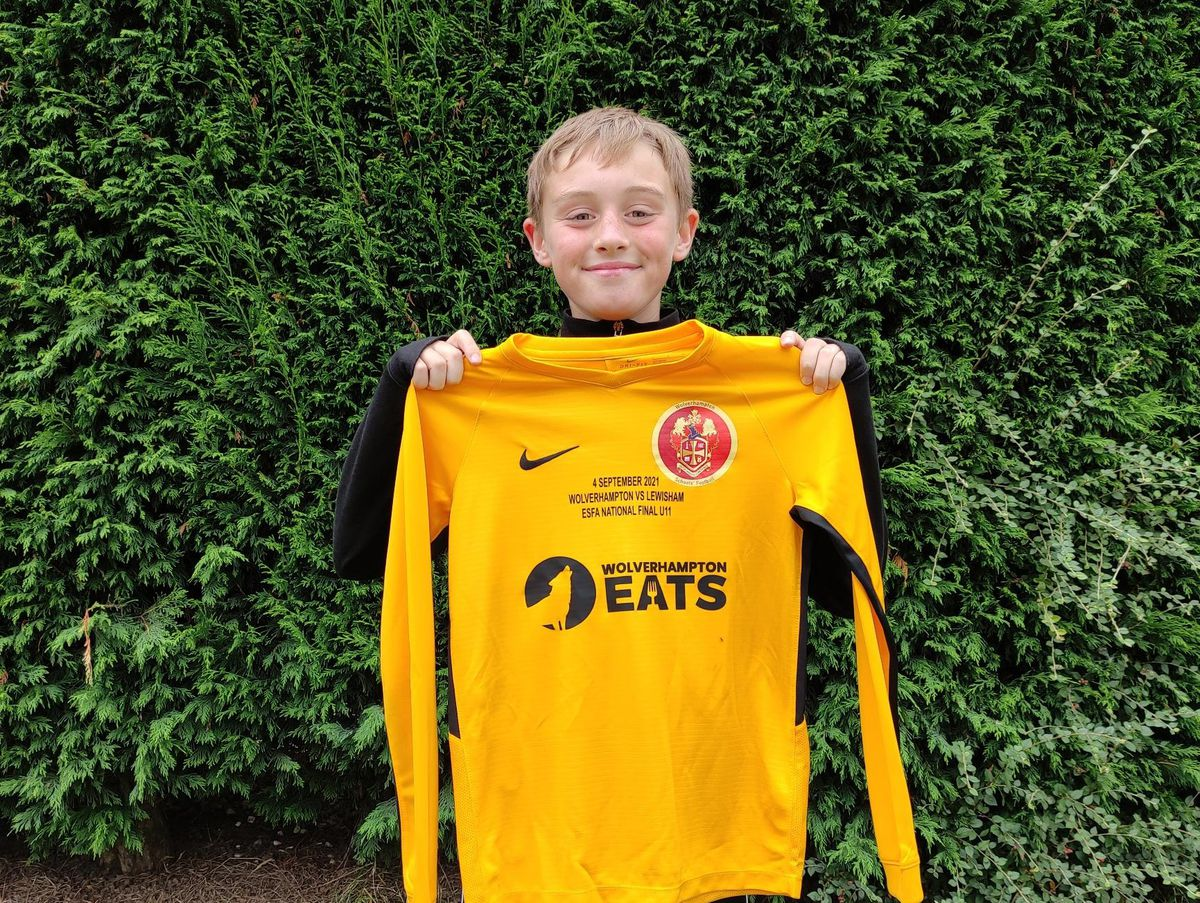 Skipper Elliot Mallin with a new shirt donated by Wolverhampton Eats