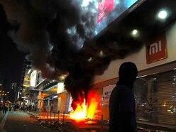 Hong Kong descends into chaos again as protesters defy rally ban