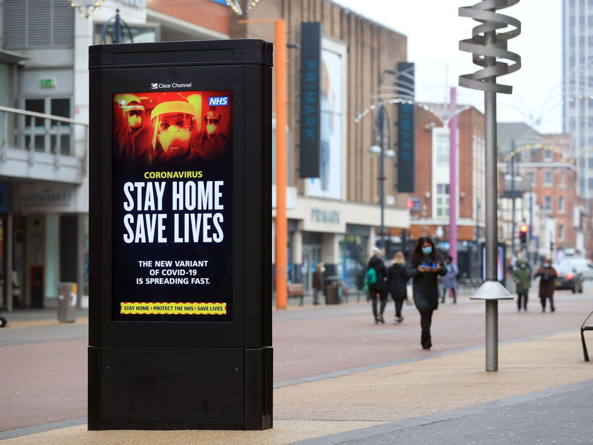 A Stay At Home, Save Lives sign