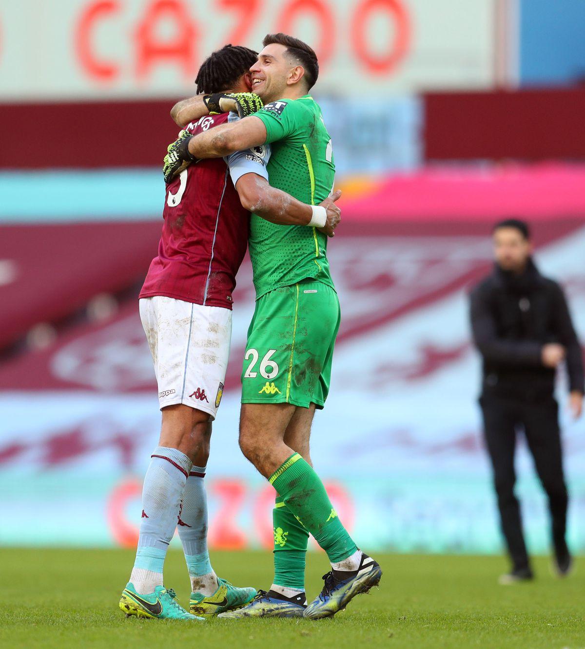 Aston Villa's Tyrone Mings celebrates with goalkeeper Emiliano Martinez following Saturday's win over Arsenal.