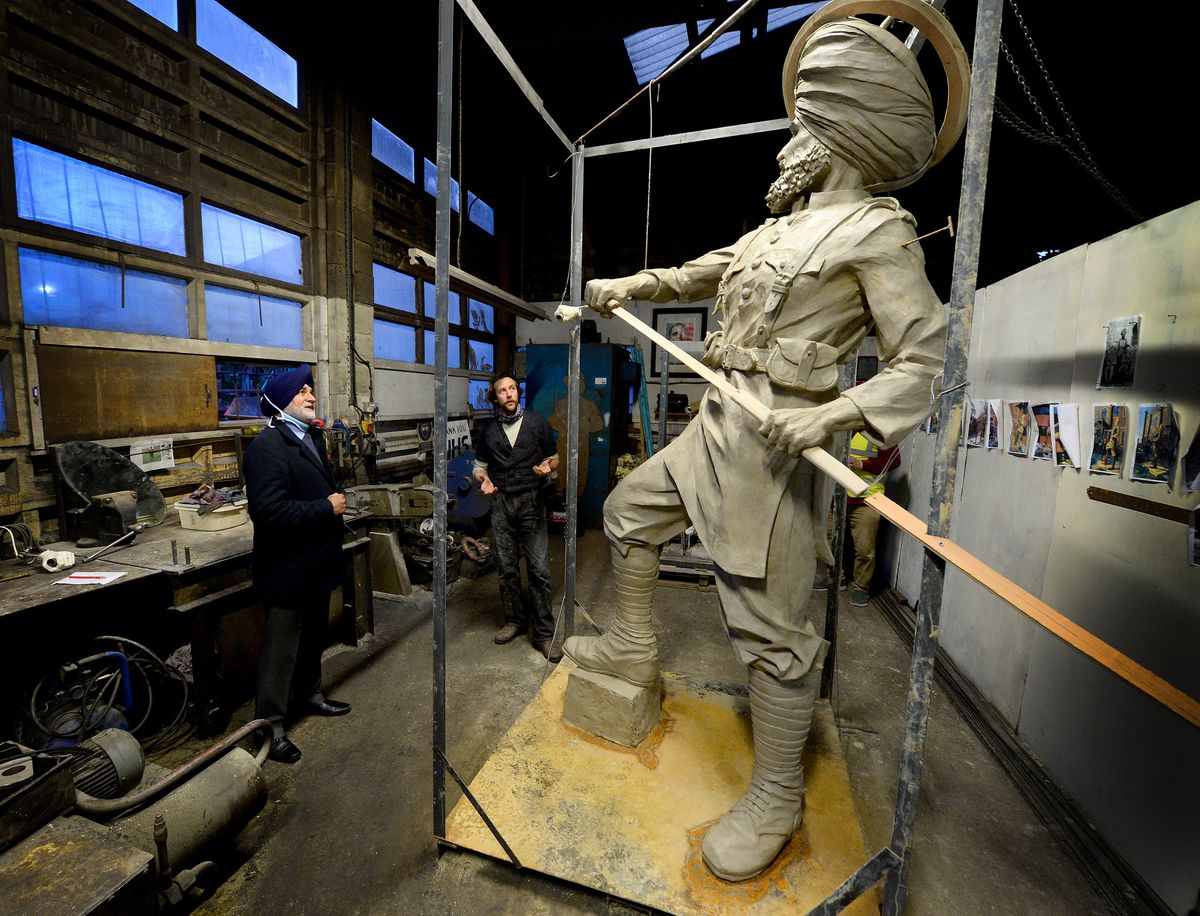 Councillor Bhupinder Singh Gakhal and members of the Guru Nanak Gurdwara in Wednesfield view the monument to the 36th Sikh Regiment being sculpted by Luke Perry
