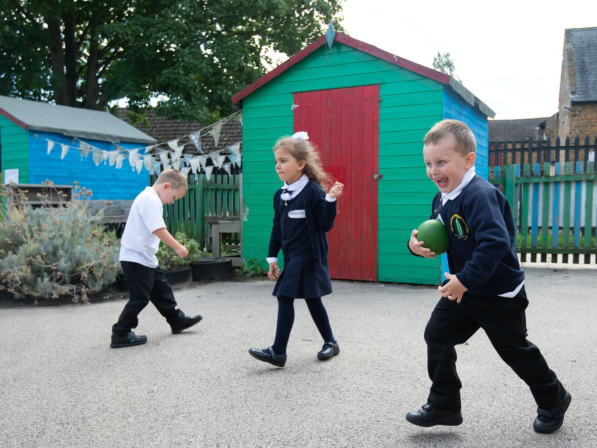 Children enjoy break time on the first day back to school at Arbours Primary Academy in Northampton