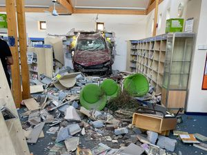 A car smashes through the wall of Hythe Library