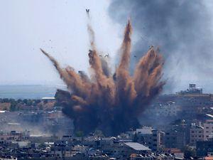 Smoke rises following Israeli air strikes on a building in Gaza City