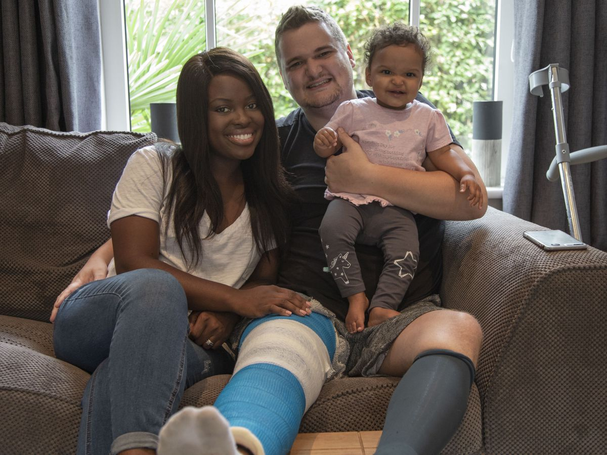 Samuel Leeds, back home safely but with a broken leg, with wife Amanda and daughter Ruby