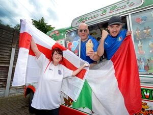 WOLVERHAMPTON COPYRIGHT MNA MEDIA TIM THURSFIELD 08/07/21 .Italian ice cream vendor and Italy fan Alfonso Urso, from Willenhall, looks forward to Sunday's match with son Carmelo. Alfonso's partner Donna supports England through and through!.