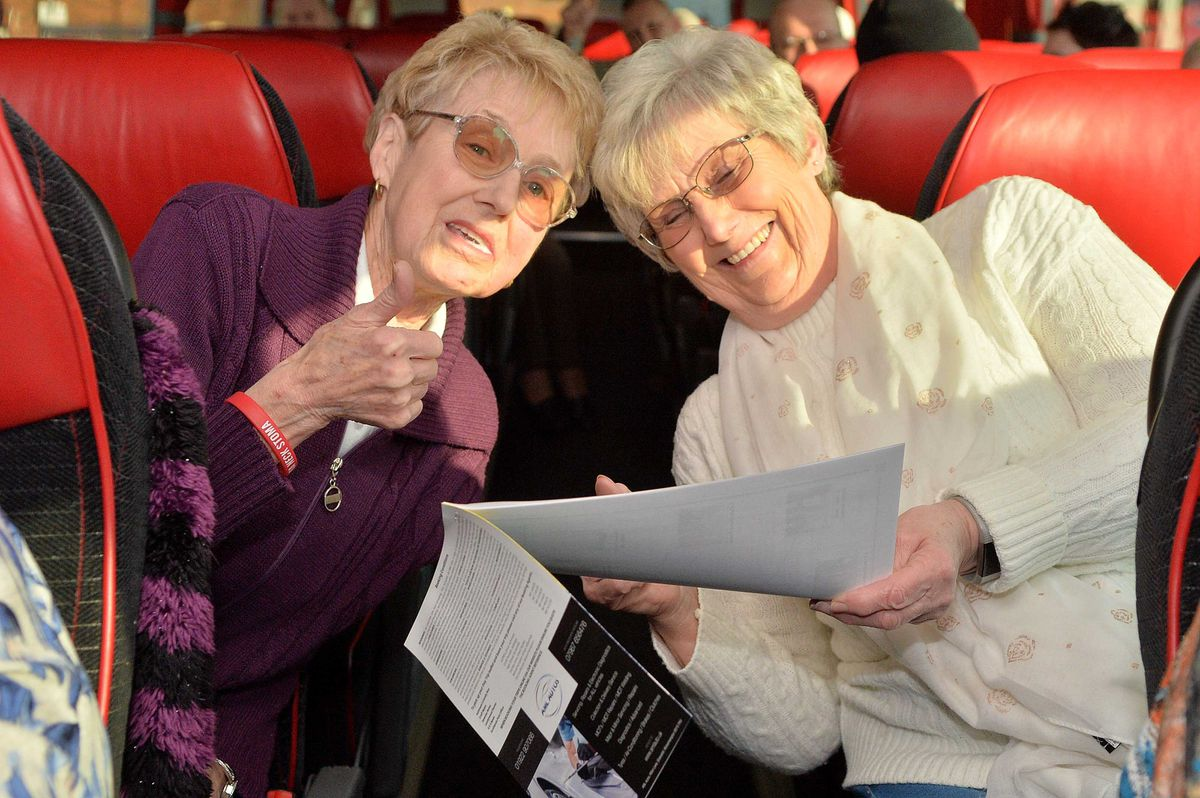 Sue Westley from Willenhall and Eileen Parry from Bentley check the maps and plan for the day