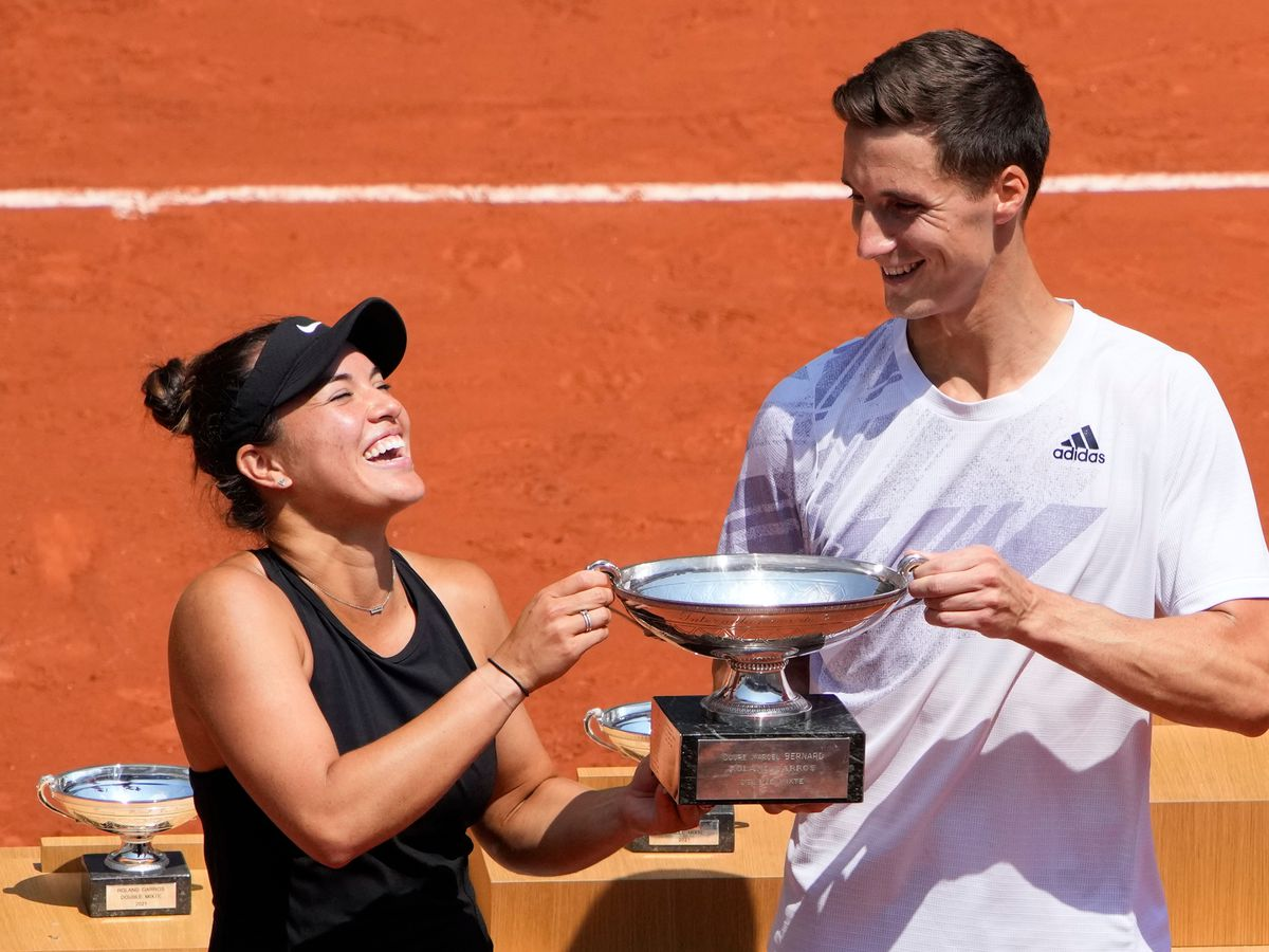 Joe Salisbury, right, and Desirae Krawczyk hold the mixed doubles trophy