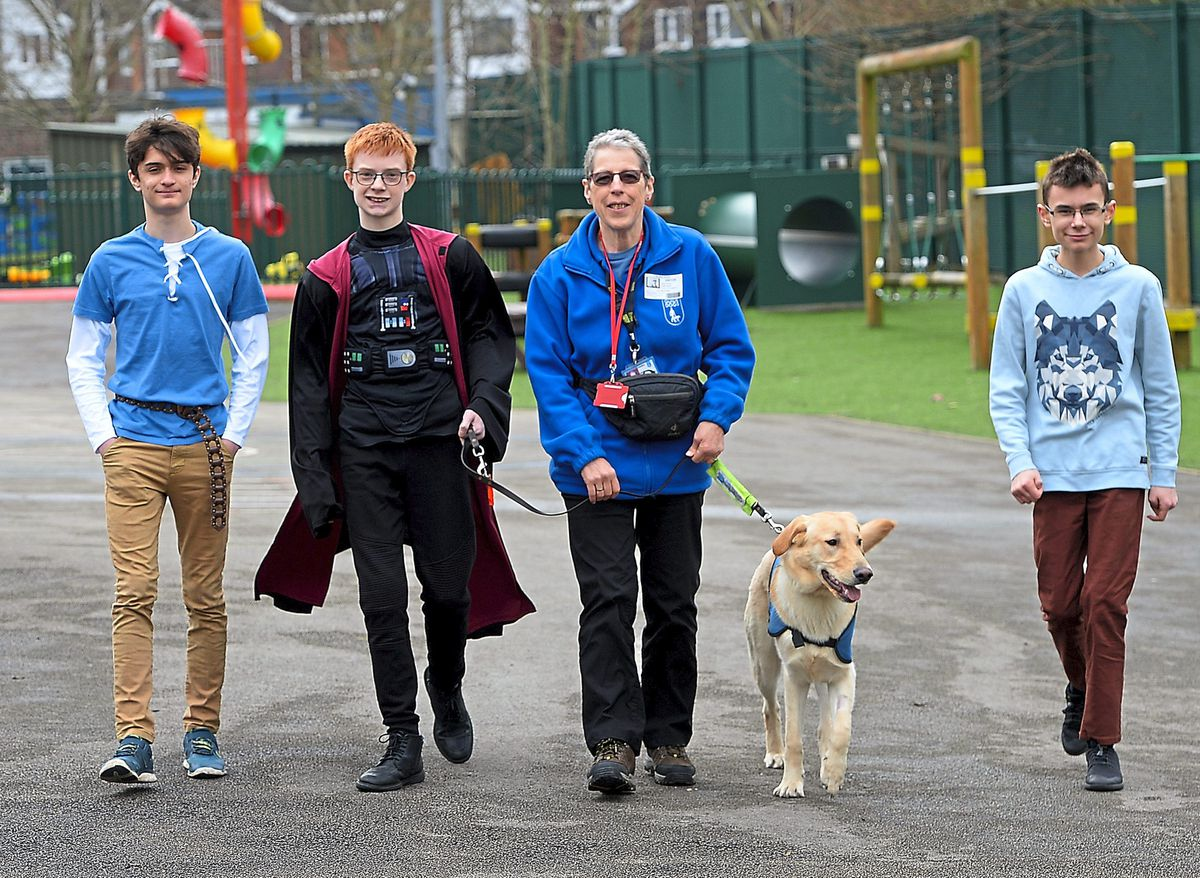 Brier School pupils Wesley Peason, Liam Sidaway and Cameron Turley with puppy walker Jackie Ayles and guide dog Russ
