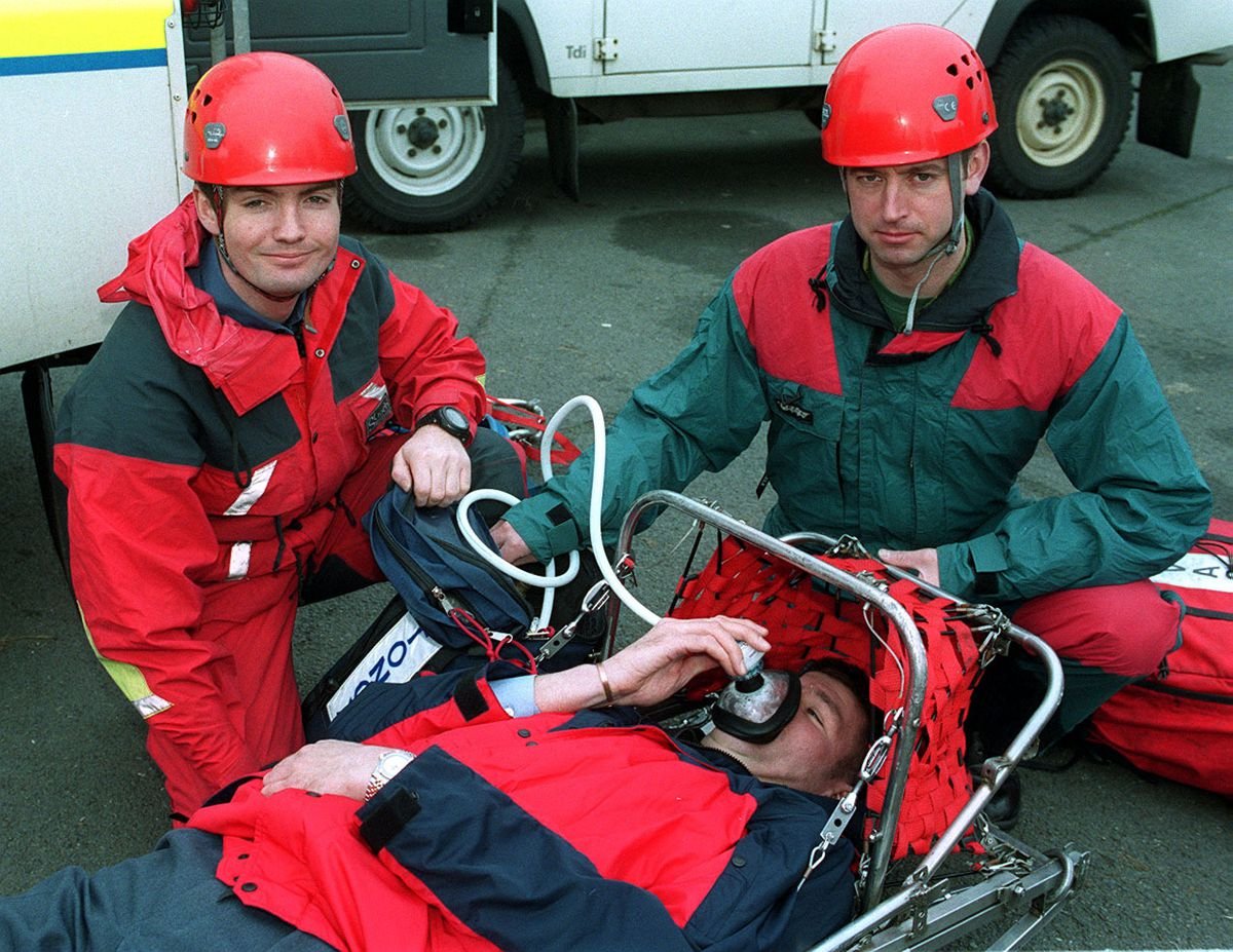 """Stafford RAF Mountain Rescue. Pictured L-R: corp Tim Sugars and SAC Colin Little """"giving oxygen"""" to sergeant Kevin Hewkin during training."""