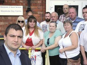 Councillor Qadar Zada and protestors at Woodside Day Centre, Dudley, in 2011
