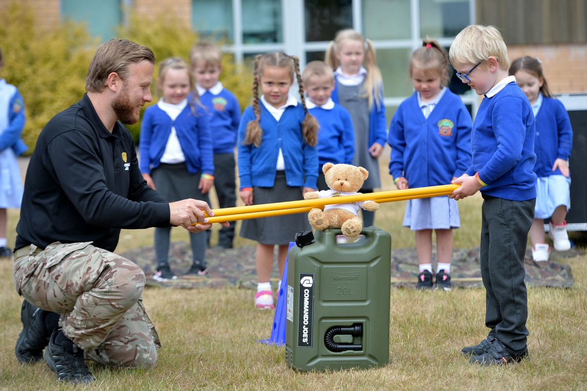 Commando Joe's instructor Stuart Wilkinson putting pupils from Landywood Primary School, in Great Wyrley, through their paces
