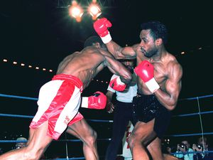Benn and Eubank exchange blows during their famous fight at the Birmingham NEC in 1990. Credit: David Jones/PA Wire