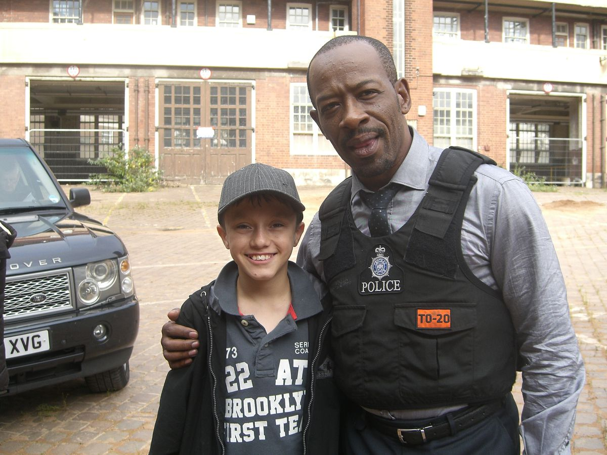 Gregory Piper at the age of 14, on set on the TV show Line of Duty with star Lennie James