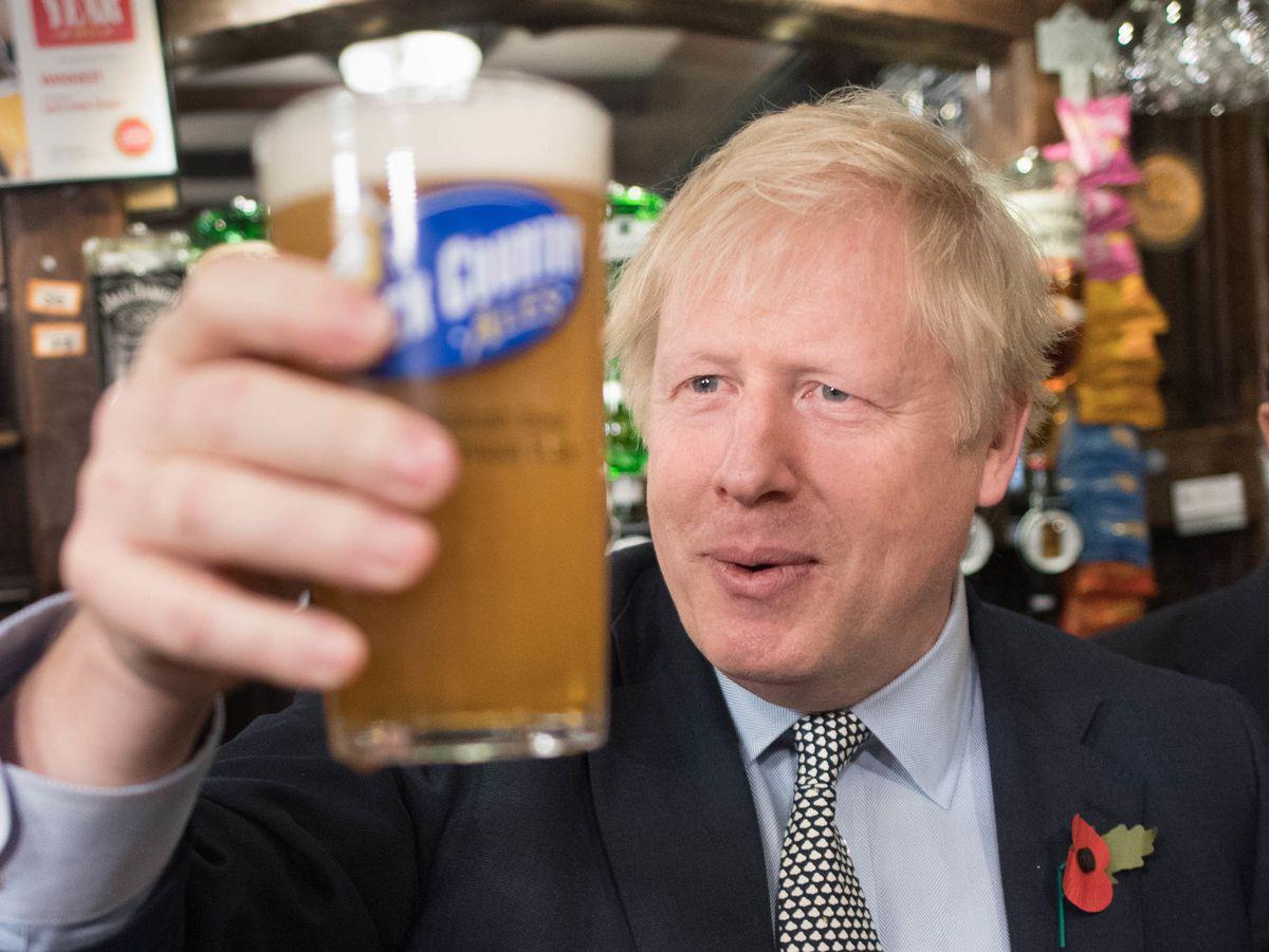Boris Johnson enjoys a drink in the Lych Gate Tavern in Wolverhampton last year