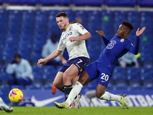 """Aston Villa's John McGinn and Chelsea's Chelsea's Callum Hudson-Odoi (right) battle for the ball during the Premier League match at Stamford Bridge, London. PA Photo. Picture date: Monday December 28, 2020. See PA story SOCCER Chelsea. Photo credit should read: John Walton/PA Wire.   RESTRICTIONS: EDITORIAL USE ONLY No use with unauthorised audio,  video, data, fixture lists, club/league logos or """"live"""" services. Online in-match use limited to 120 images, no video emulation. No use in betting, games or single club/league/player publications."""