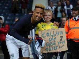 A young West Bromwich Albion Fan get the match worn shirt of goal-scorer Callum Robinson of West Bromwich Albion at the end of the match.