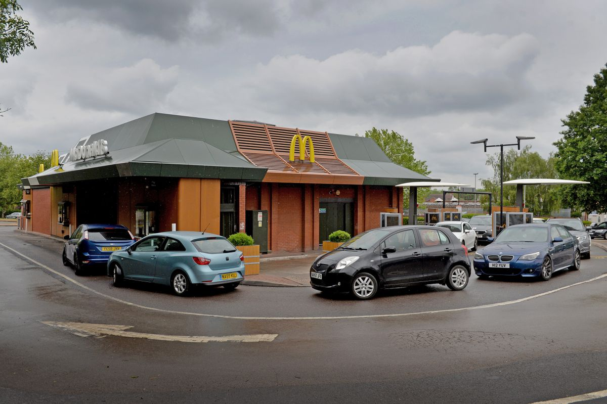 A long queue of cars at the drive-thru for the Penn Road McDonald's