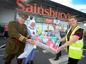 CANNOCK COPYRIGHT MNA MEDIA TIM THURSFIELD 11/06/21 .Alan and Jacky Baldwin from Lichfield Barracks, accept the hamper from Kerry Flint and manager Sophia Evans from Sainsbury's, Cannock. The hamper is being donated towards a fundraiser for a little boy with rare bone cancer..