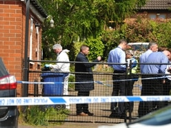 Investigations continue after woman and man found dead at Hednesford house