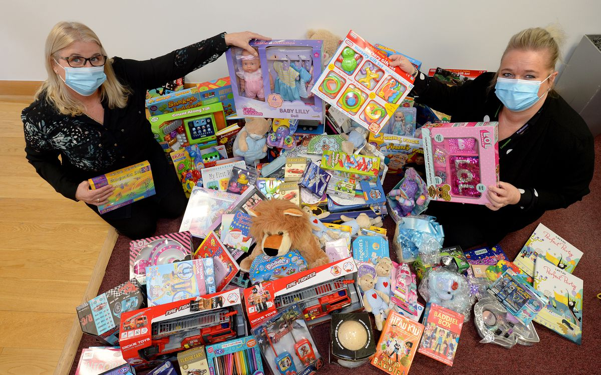 Anchor Estates, Aldridge, hands over presents to Walsall Manor Hospital at their shop having successfully ran a toy collection campaign. Pictured are office manager Lorraine Busby and hospital fundraising manager Georgie Westley