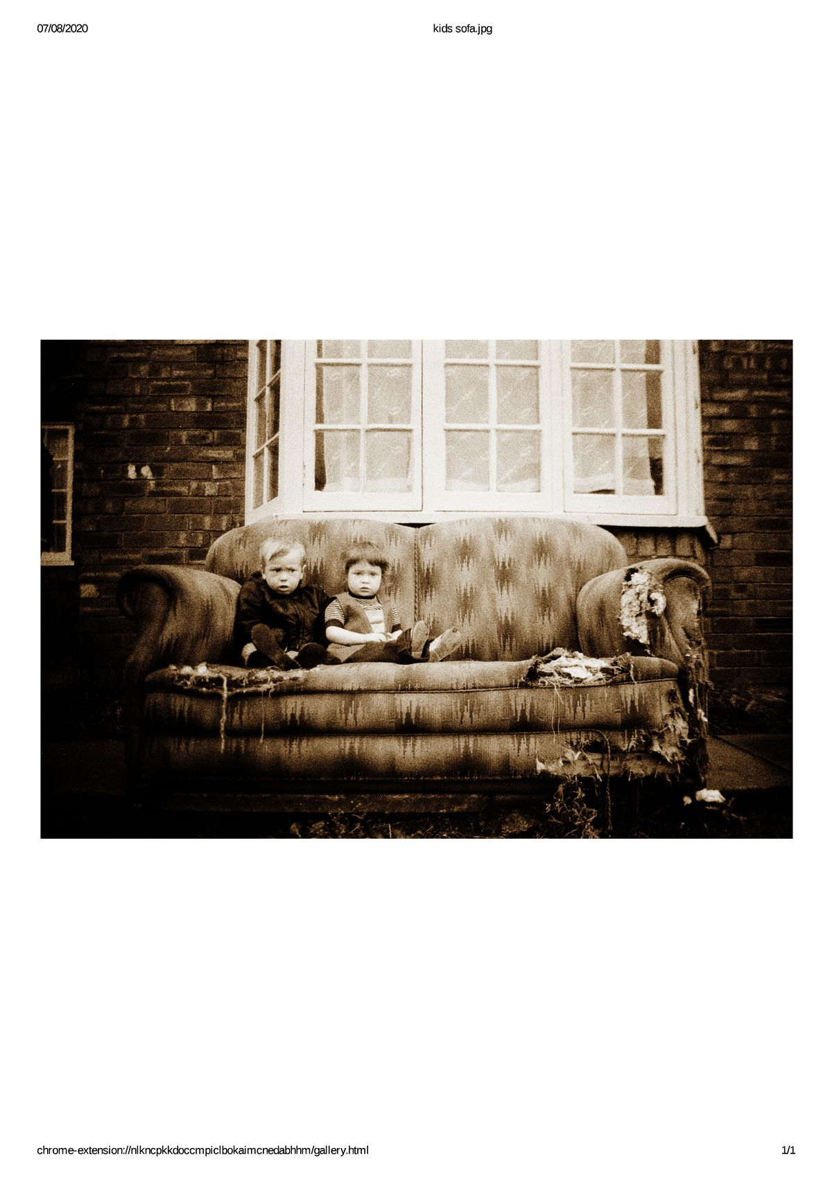Joanne and Malcolm Smith sitting on an old sofa on the Scotlands estate in 1973
