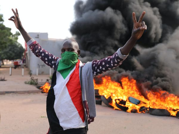 A demonstrator gives the victory sign at a protest, in Khartoum, Sudan (Marwan Ali/AP)