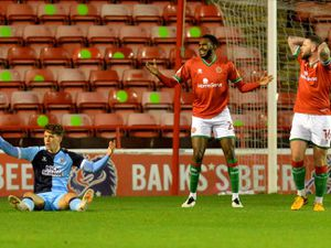 SPORT COPYRIGHT EXPRESS AND STAR STEVE LEATH 27/10/2020..Walsall FC V Cambridge FC.  W: Hayden White fouls   V C:  Luke Hannant to give away a penalty.