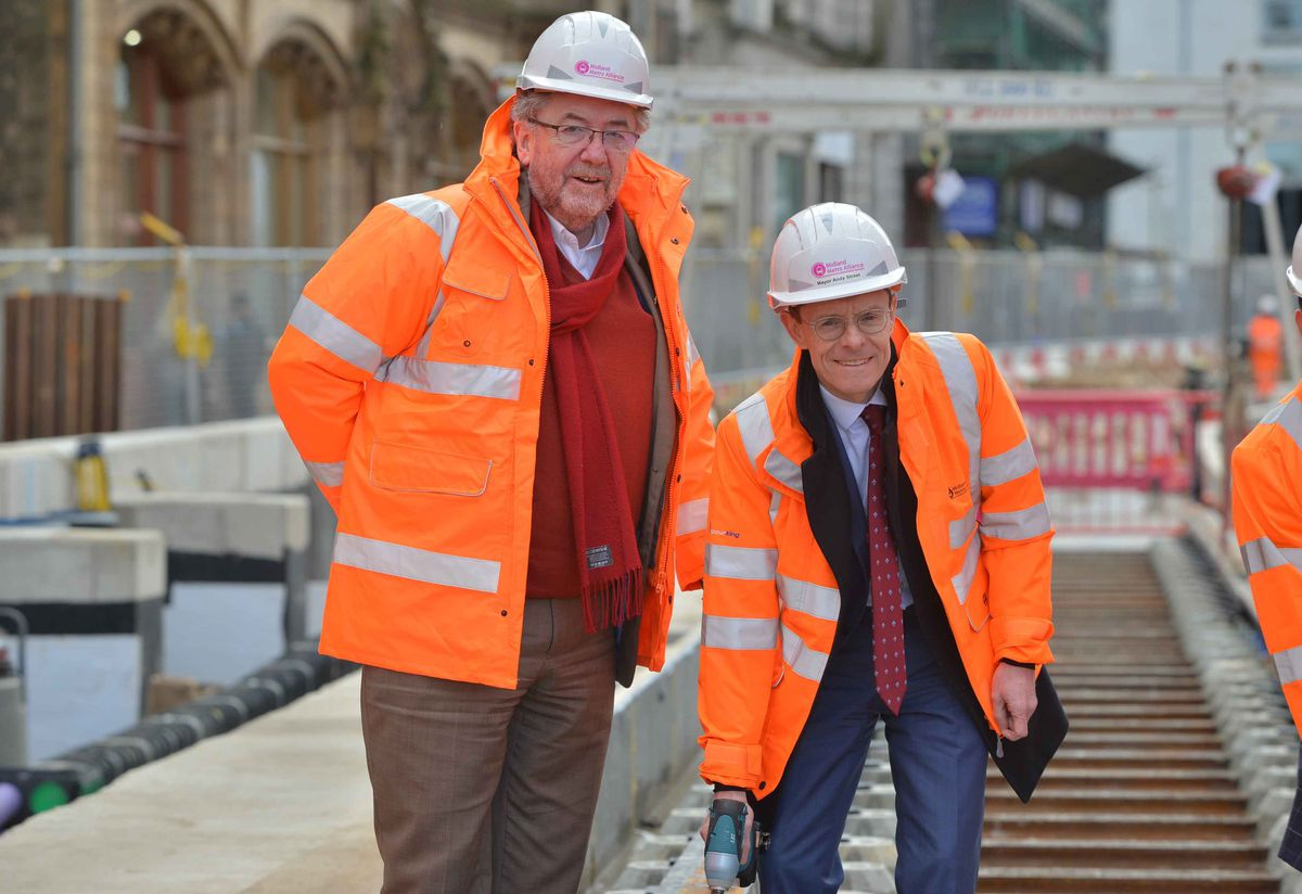 WMCA transport chief Roger Lawrence and Mayor Andy Street saw the laying of the first tracks for the Westside Metro extension