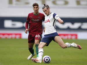 Wolverhampton Wanderers' Theo Corbeanu (left) and Tottenham Hotspur's Gareth Bale in action